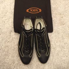 """TOD'S black sneakers driver shoes sz 37 w/accents! Beautiful black leather TOD'S lace up sneakers with classic TOD'S rubber driver dotted sole with elegant white stitching, size 37. Comes with original dust bag. 100% authentic. Hardly worn, the soles look excellent! Fantastic condition and you'll love the """"T"""" button on the heel as well as TOD's logos by the heel. Stylish and sportif! Open to reasonable offers  Tod's Shoes"""