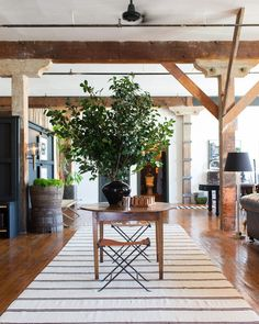 Divide an open loft into sections with contrasting area rugs.  Click through for more home makeover tips from the founders of design firm Hammer and Spear.