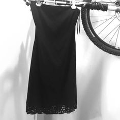 Tahari black halter dress lace trim hem - small Excellent condition.  Thin halter string goes over the head, behind the neck.  Zipper at back Tahari Dresses