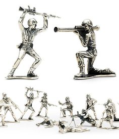 Silver Army Men  If you grew up staging elaborate battles or even just chewing the heads off of green plastic toy Army Men, this collection of classic Army Men rendered in sterling silver will take you back. The collection includes 13 different 2-inch figures with all the classic poses & weapons.