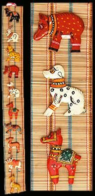 Wall Hanging Mats that we offer look very appealing and unique for decorating interiors at homes and offices. Its made up off bamboo slice weaven mats and Wooden Animal figures pasted on it which is long lasting as well as attractive looking. We provide a wide array of beautifully crafted Bamboo Handicraft Items.