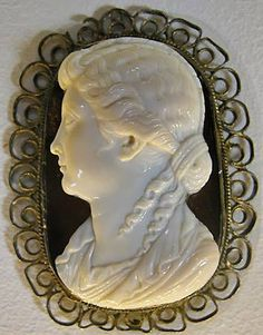 Cameo portrait of a woman whose hairstyle places her in the Augustan period (late BCE-early CE). Paris: Bibliotheque Nationale. Modern frame