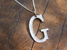 love the font of these necklaces.  G for Garst.