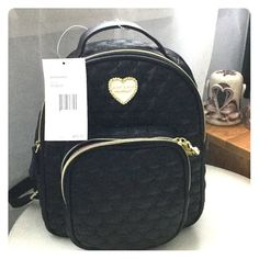 Betsey Johnson mini backpack This backpack is black with little heart pattern. Black hand strap and black back straps Betsey Johnson Bags Backpacks