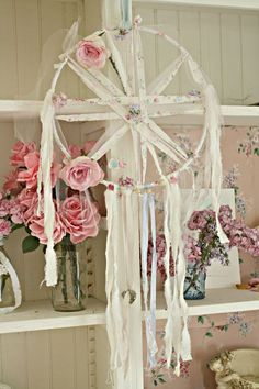 Dreamcatcher or fairy star made with ribbon and flowers