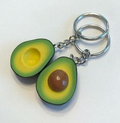 This listing is for two avocado slice key chains made from polymer clay. Each avocado slice will feature a unique blend of yellows and greens and may vary slightly (as real avocados do) between pairs. Avocados measure approximately 1 1/4 in length and are durably attached to a key chain and ring. Please note that since these are 100% handmade, the two slices will not fit perfectly together. Enjoy :)