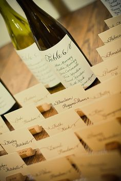 Cute idea for seating guest... Bottle of wine or champagne for each table, with their name on it.