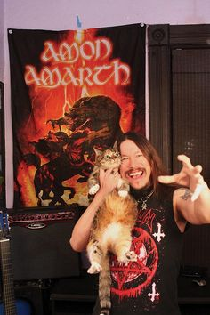 """Metal Cats: Hardcore Metal Musicians Pose With Their Cats via Bored Panda (I should have an """"Aw, Cute!"""" folder instead, but too much work right now. This one's my favorite. That cat looks so cute. """"Papa! You loves me!"""")"""