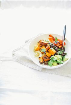 simple sweet potato + black bean burrito bowls with cumin garlic drizzle // @thefirstmess