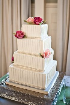 Wedding Cake Design: Buttercream with vertical stripes and pearls. I like this design because it has a classic look without being too overwhelming with details and color. I am NOT a fan of fondant.. so this is a good buttercream option without having to u
