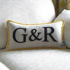 A graphic style, modern wool cushion personalised with the initials of a special couple. £49.50
