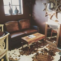 Nth Degree Home Theodore Alexander mirror $799 Cow hide rug $599 Accent table $499 Alder & Tweed settee $1799