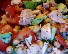 One avocado, one tomato, diced chicken, chickpeas (garbanzos), basil, pepper, lime juice, and white wine vinegar.... Clean eating quick dinner for one!!!