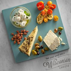 Engage all of your senses by livening up your summer cheese board with bold colors, varied textures and distinctive flavors. Features our Rosemary and Olive Oil Asiago in the lower left corner