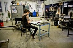 Carrie Iverson working at Shatter Glass studio.