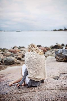 Layered knits. Light grey leggings, white long sleeve tee, camel cable knit cashmere