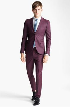 A deep allover jewel tone pops on an ultra-skinny blazer for a contemporary take on a classic style. // ok, that is a gorgeous suit. wow.