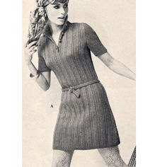 Junior Casual Ribbed Dress Knitting Pattern  This is a Juniors sized dress pattern.   The dress is of straight and easy-to-wear fare.  It features a wide ribbed horizontal pattern stitch with short sleeves, a raised collar and short front button band.   Wear with optional belt .. or not.