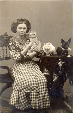 Teenage girl with her two cats and a dog
