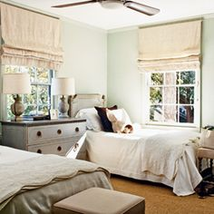 again with the girls' room layout. 25 Charming Guest Rooms | Cozy and Inviting | CoastalLiving.com (like dresser in middle)