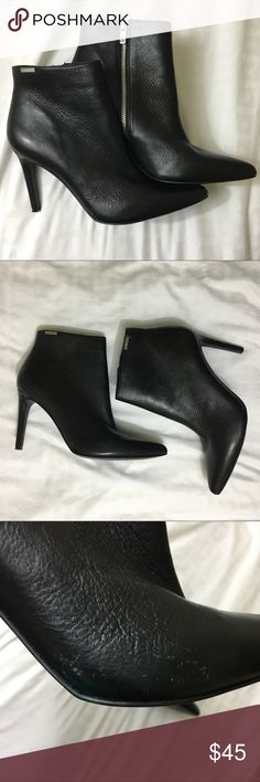 Calvin Klein Clariss Black Leather Booties Super trendy and super adorable Black booties from CK. Pointed Toe and a killer heel. Exposed silver zipper on the side. There's a small area where the leather appears to have flecked off but it's a small area, please see picture. These are in otherwise great condition. Live long and poshper 🖖🏼 Calvin Klein Shoes Ankle Boots & Booties