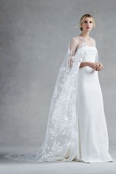 Oscar de la Renta Bridal Fall 2017: Strapless column gown with sheer floral appliqué cape