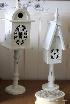 bird houses- looks like you could DIY- glue bird houses to candle stick holders, then paint.