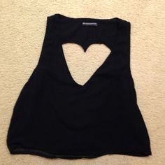 ❤️ Super cute black Brandy Melville tank top❤️ Super cute black sheer top with heart cut out back super cute and must have great condition (trade value $25.00) Brandy Melville Tops