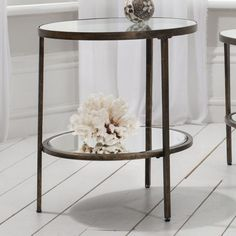 Hunter Side Table  Striking round companion table in an aged bronze finish.