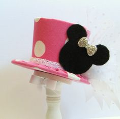 Mini Top Hat Headband, Pink Minnie, Alice in Wonderland themed Tea Party, Birthday, Costume, Photo Prop, Gift from Truly Sweet Circus. $19.95, via Etsy.