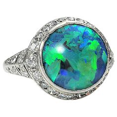 """J. E. Caldwell Black Opal  Diamond Ring  American  Circa 1925  Jewelry from the Art Deco era was regarded as """"uber-modern"""" and platinum was the ultimate metal of choice for elegance and sophistication of the age."""