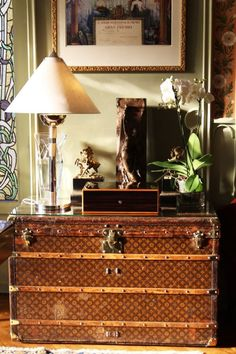 Unique alternative to furniture, use an old Vintage Louis Vuitton trunk.