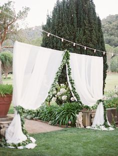 Reception Entrance with Drapery & Foliage | Photography: Lane Dittoe Photography. Read More:  http://www.insideweddings.com/weddings/charming-wedding-at-california-estate-inspired-by-european-villa/817/