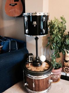 Broken CB drum turned into an industrial chic lamp with a hammered metal finish.  For more musical lighting, gifts, and art  visit us at:  www.musicasartbysarah.etsy.com