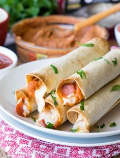 Pizza Hummus Taquitos    All we need is food