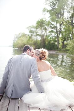 This is the kind of wedding where the bride and groom stun you with one romantic meets rustic detail after another and then proceed to jump into the lake to cool off... and really get the party started. They are just