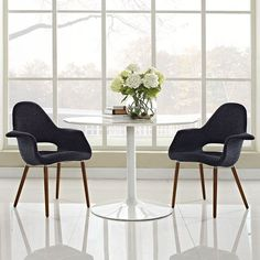 Aegis Dining Armchair Set of 2, Black - Repose in a chair that constantly forms and reforms new definitions of reality. Let tensions fade away as you embrace the ability to initiate and innovate. Four wooden legs support the diagonal look of the Aegis Accent Chair where fresh ideas are spun. Set Includes: Two - Taupe Accent Chair. Material: Linen fabric, Beechwood legs, ABS frame, Chrome plated aluminum leg connectors. Weight: 30. Assembly Required