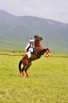 Kyrgyz Turk Woman on Horseback  Kyrgyzstan, Central Turan