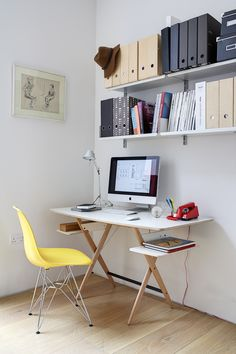 Home office. Scrittarello desk by Achille Castiglioni from TwentyTwentyOne. The DSW Eames chair is from Aram and  the 606 Universal Shelving System  is by Vitsoe.