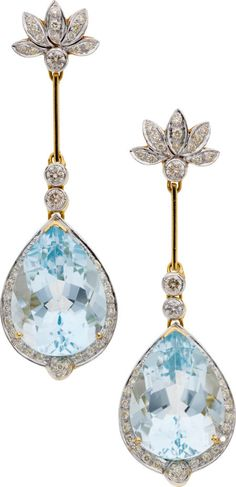 Blue Topaz and Diamond, Gold Earrings-The earrings feature pear-shaped blue topaz measuring 22.00 x 18.85 x 10.50 mm, respectively, and weighing a total of approximately 51.50 carats, enhanced by full-cut diamonds weighing a total of approximately 0.60 carat, accented by yellow diamonds weighing a total of approximately 0.85 carat, set in 14k gold, completed by posts and friction backs (colored diamonds not tested for origin of color