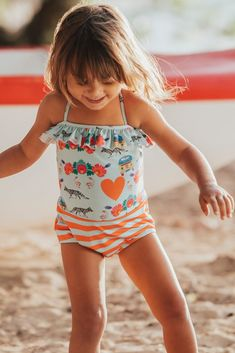 This unique one piece is combines two exclusive Lului Bikinis prints with an adorable top ruffle and skinny crisscross straps and shorts style bottom. Made with certified UPF Brazilian Lycra. Bikini Girls, Bikini Set, Little Girl Fashion, Swimsuits, Swimwear, One Piece Swimsuit, Lily, Skinny, Shorts