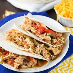 Easy Slow Cooker Chicken Fajitas- 4 ingredient chicken fajitas slow cook in the crock pot all day long to create a satisfying, delicious meal without much effort!