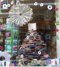 Book art hanging in the window - made of book pages.  Oxfam Bookshop: Petergate, York.. Upcycled #Christmas Tree!