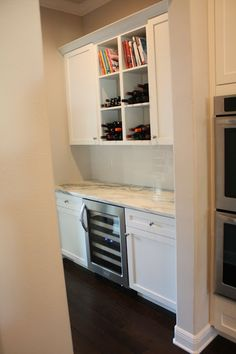 Vermont Danby top with wine cooler and open shelving, white on white kitchen