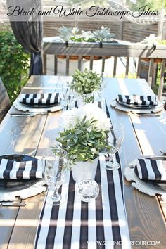 Black and White Tablescape Ideas | I love how these easy centerpieces and napkins show off this farmhouse table! www.settingforfour.com
