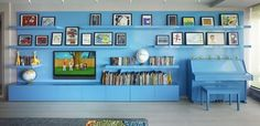 Even the piano is aqua!!!!! Bohemian Apartment Blue Shelving - eclectic - family room - new york - Incorporated