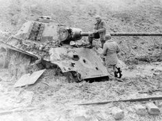 American soldiers inspecting a Panther Ausf G that has several penetrations through the front hull glacius plate