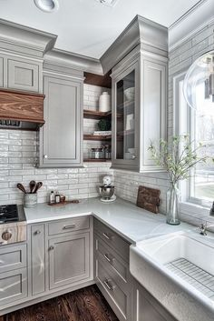 gray kitchen floor hammered nickel sink creamy white cabinets paired with supreme quartzite image