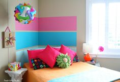 Perfect Painted Stripes make a cool DIY Headboard l Tutorial by Fresh Idea Studio