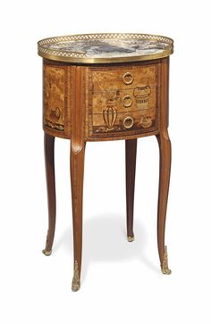 A FRENCH ORMOLU-MOUNTED TULIPWOOD, AMARANTH, BOIS SATINE AND STAINED FRUITWOOD MARQUETRY BEDSIDE TABLE LATE 19TH CENTURY